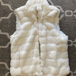 White fur vest with inside pockets